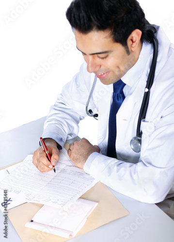 The doctor writing on the desk