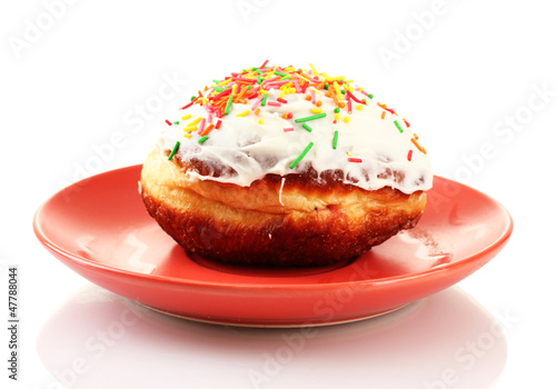 Tasty donut on color plate isolated on white