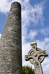 Round tower and celtic cross in Glendalough, Ireland