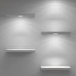 Empty shelfs illuminated by spotlights