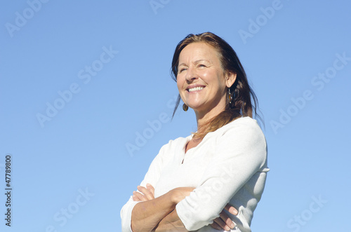Happy friendly relaxed mature woman