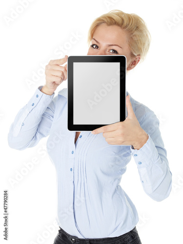 Business woman watching over her tablet pc with copyspace