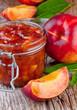 nectarine, peach jam on wood background