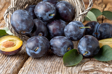 group of fresh plums on wood  background
