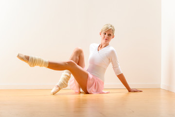 Young beautiful ballerina exercising in the studio