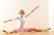 Ballet dancer lifting arms exercising in studio