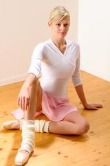 Ballet dancer sitting on the studio floor