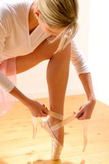 Ballet dancer getting ready for ballet performance