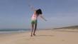 female flying at beach 45