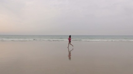female running on seashore