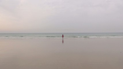 red jersey woman coming from the sea 40