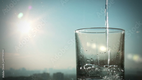conceptual footage of pouring water against blurred city