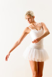 Ballet dancer exercising dance move in studio