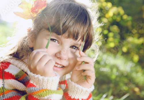 Little Girl Outdoors on Sunny Day