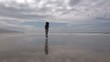 woman on beach jogging