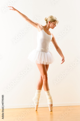 Beautiful ballet dancer practicing dance posture