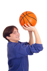 Chealy teenager playing basketball