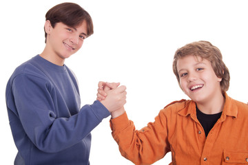 Happy young friends shaking hands