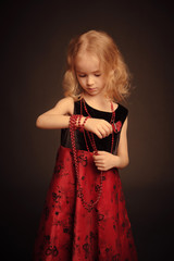 Little girl with beads