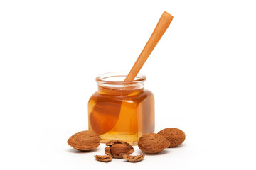 Honey in the jar and almonds