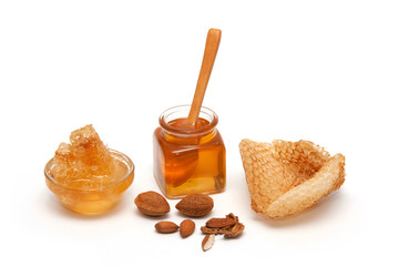Honey, Honeycomb and almonds isolated