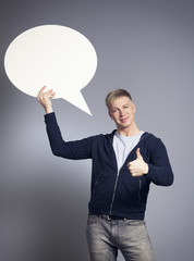 Friendly man presenting empty speech bubble.