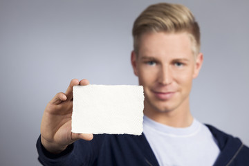 Friendly man presenting empty white card.