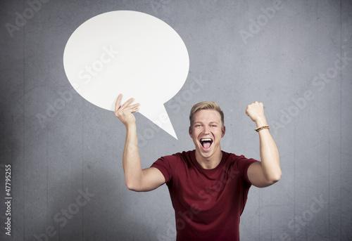 Successful man holding empty speech balloon.