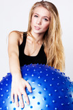 Young  woman with fitball, isolated over white background