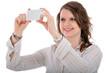 Junge Frau nimmt Selbstportrait auf