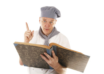 Cook chef is giving an advice or recipe from cookbook