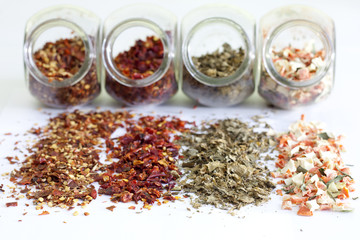 Dried spices in jar on white background closeup