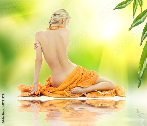 beautiful woman in spa with towels
