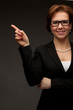Young beautiful business woman pointing at copyspace