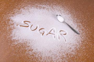 zucchero rovesciato sul tavolo