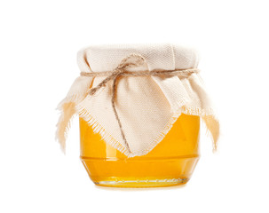 honey in jar isolated on white
