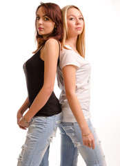 Two curvy young woman standing back to back