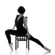 pretty young ballerina sitting on the chair.