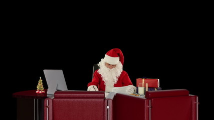 Santa Claus reading letters, against black