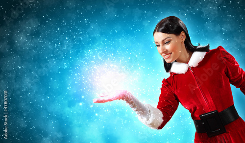 Portrait of girl wearing santa claus clothes