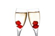 cheers, red dice in two champagne flutes with gold bubbles