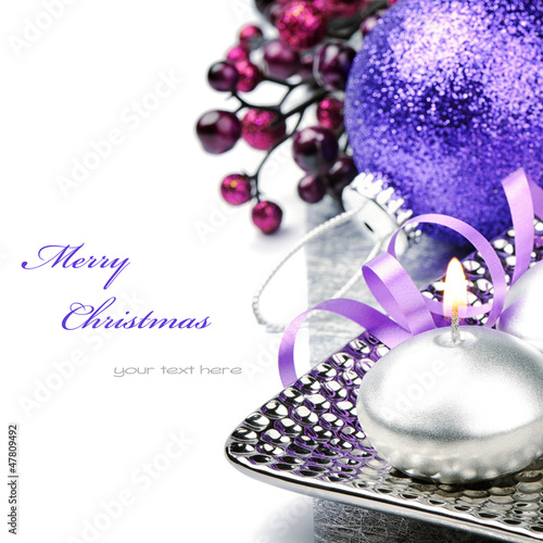 Festive candle and purple Christmas ball