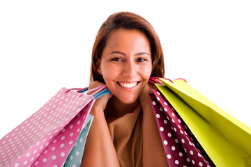 Portrait of a happy smiling woman holding shopping bags against