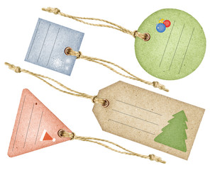 Set of Christmas paper tags with strings, isolated