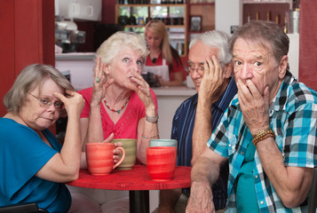 Embarrassed Seniors with Loud Friend