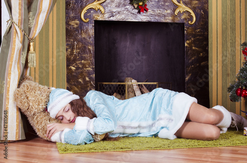 nice teen girl sleeping near fireplace