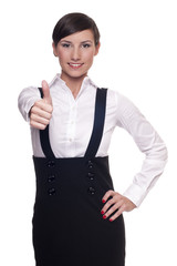 Young businesswoman showing thumbs up gesture