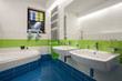 Travertine house - colorful bathroom
