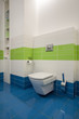 Travertine house - blue and white bath