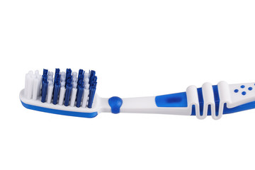 Close up of a blue toothbrush isolated on the white background